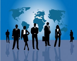 Business silhouettes in front of world map